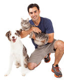 Handsome Man With Dog and Cat Stock Photography