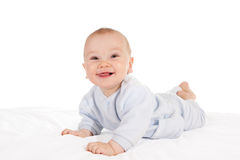 Happy baby lying on tummy Stock Photos
