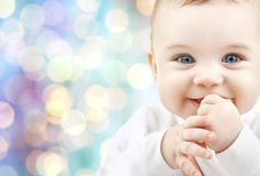 Happy baby over blue holidays lights background Stock Image