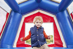 Happy boy in bounce house Stock Photography