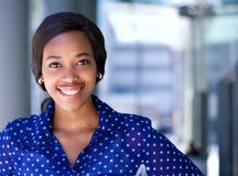 Happy business woman smiling outside office building Royalty Free Stock Photo