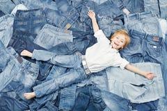 Happy child on jeans background. Denim fashion Stock Photo