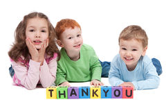 Happy children with thankyou kids letter blocks Royalty Free Stock Photography