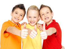 Happy children with thumbs up gesture Royalty Free Stock Images