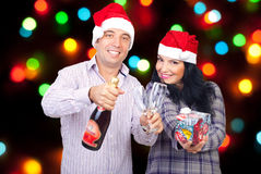 Happy couple celebrating Christmas Royalty Free Stock Images