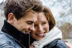 Happy Couple Embracing Outdoors Stock Images