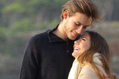 Happy couple hugging in love outdoors Royalty Free Stock Photos