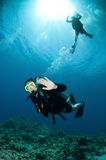 Happy couple scuba dive together Royalty Free Stock Images