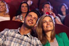 Happy couple watching movie in cinema Stock Images
