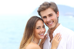 Happy couple with a white smile looking at camera Stock Image