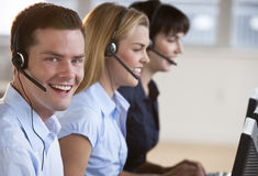 Happy Customer Service Reps Royalty Free Stock Photography