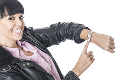Happy Delighted Young Woman Pointing to her Watch Royalty Free Stock Photos