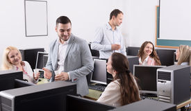 Happy employees and manager celebrating Stock Images