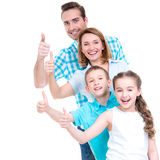 Happy european family with children shows the thumbs up sign Stock Photo