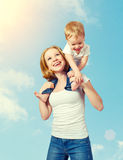 Happy family. baby sits astride the shoulders of the mother and Stock Photography