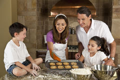 Happy Family Baking & Eating Cookies In A Kitchen Stock Photography