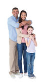 Happy family embracing each other over Royalty Free Stock Images