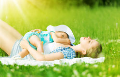Happy family. Mother and baby are resting, relax sleep Stock Image