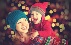 Happy family mother and little daughter playing in the winter for Christmas Stock Image