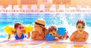 Happy family in the pool Stock Photos