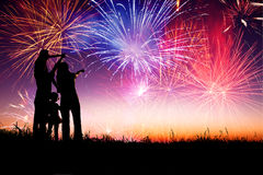 Happy family  watching the fireworks Royalty Free Stock Photography