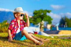 Happy fashionable kid on summer meadow Stock Photos
