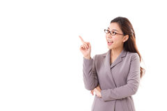 Happy female business executive, business woman pointing up Royalty Free Stock Photo