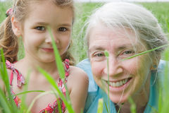 Happy girl child and grandmother in field Stock Photography