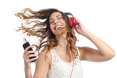 Happy girl dancing and listening to the music Royalty Free Stock Photo