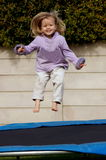 Happy girl jumping Stock Image