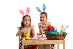 Happy girls decorating easter eggs Stock Photography