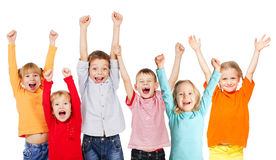 Happy group children with their hands up Royalty Free Stock Image