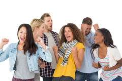 Happy group of young friends cheering Stock Image