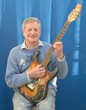 Happy Guitar teacher. Stock Images