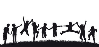 Happy jumping children silhouettes Stock Image