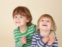 Happy Kids Hugging and Smiling Stock Image