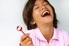 Happy lollipop girl Stock Image
