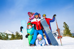 Happy mates with snowboards and skis Royalty Free Stock Images