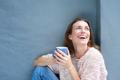 Happy mid adult woman laughing with a cup of tea Royalty Free Stock Images