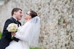 Newlywed couple embracing Stock Image