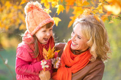 Happy parent and kid holding autumn yellow Stock Image