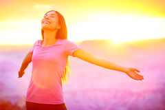 Happy people - free woman enjoying nature sunset Stock Photography