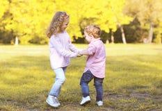 Happy positive children having fun in autumn day Royalty Free Stock Photos