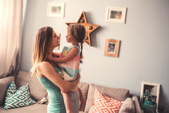Happy pregnant woman with her toddler daughter at home Royalty Free Stock Image