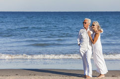 Happy Senior Couple Embracing on Tropical Beach Royalty Free Stock Photography