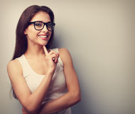Happy successful smiling young woman in glasses thinking. Vintag Royalty Free Stock Photography