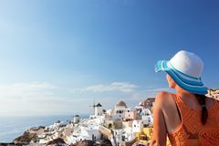 Happy tourist woman on Santorini island, Greece. Travel Stock Photos