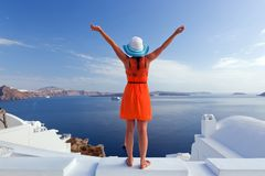 Happy tourist woman on Santorini island, Greece. Travel Stock Photo