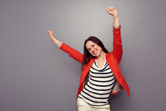 Happy woman celebrating Stock Images