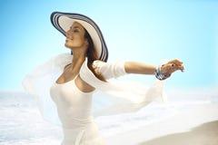 Happy woman enjoying summer sun on beach Stock Photos